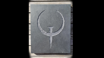 Резчик по камню выполнил заказ, нарисовав логотип Quake