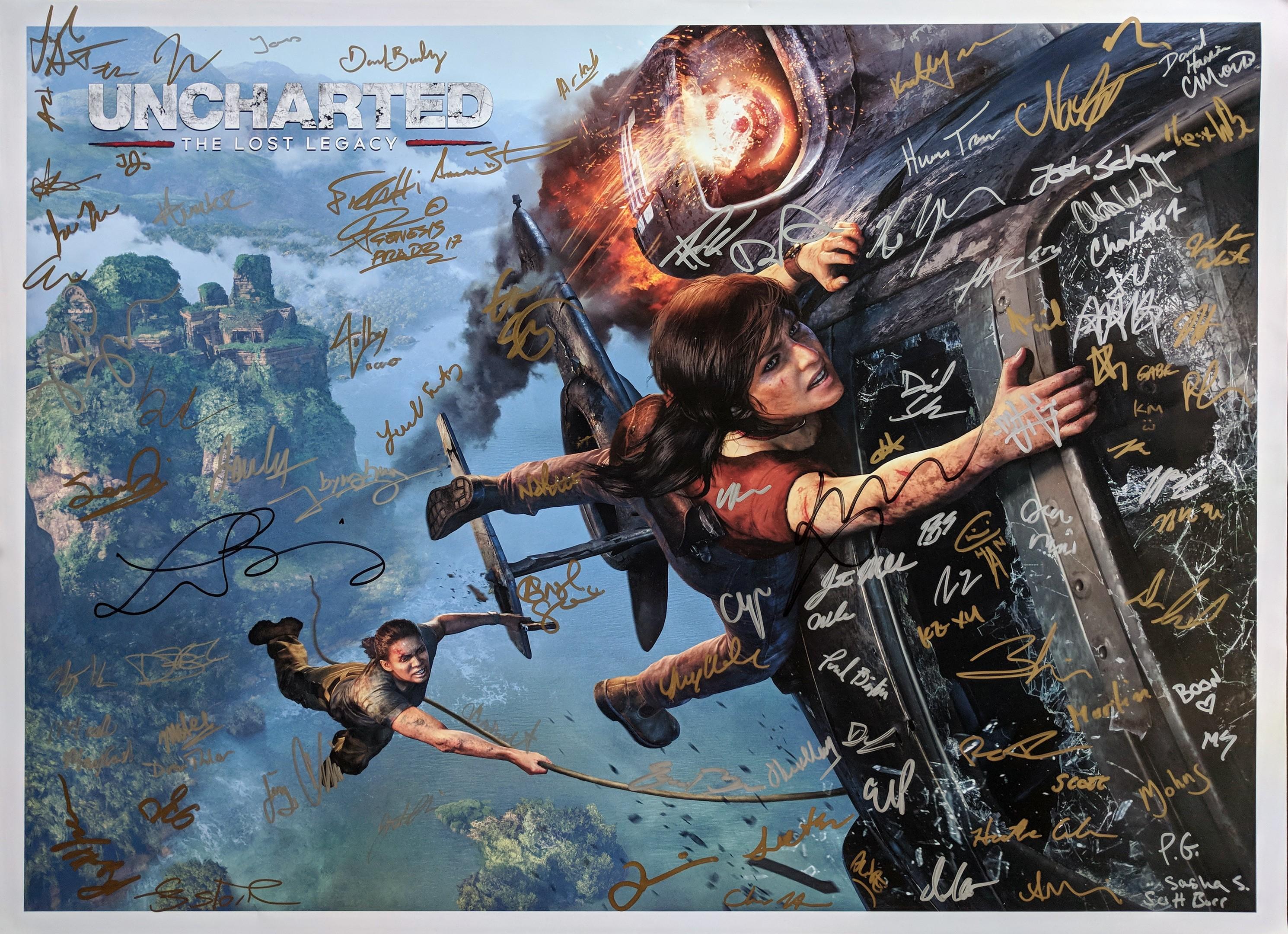 постер Uncharted The Lost Legacy с изображенными на нем главными героинями и автографами сотрудников, принимавших участие в работе над игрой - Uncharted: The Lost Legacy
