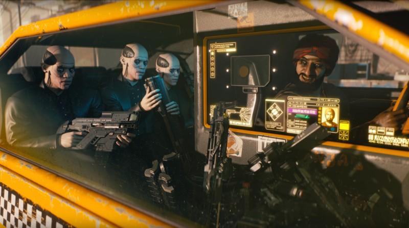 Автомат Kang Tao в руках у крайнего слева пассажира индусского такси
